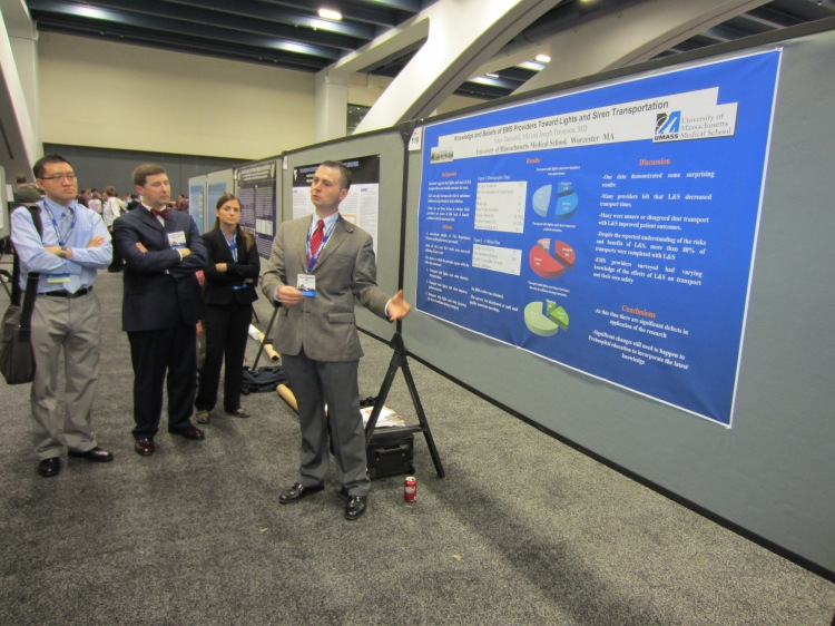 Adam presenting a scientific poster at EMS conference