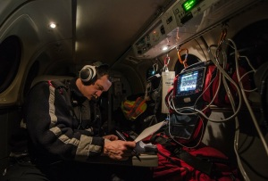 A colleague doing some charting while flying a late night medevac from Paulatuk NT to Inuvik NT.