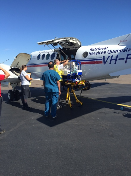 Neonatal Retrieval team from Townsville loading transport incubator onto RFDS aircraft
